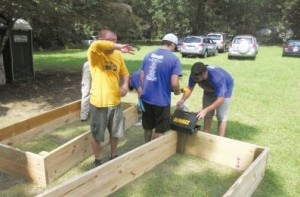 Volunteers from Blackbaud help build garden boxes for Charleston Parks Conservancy. Photo by Bill Davis